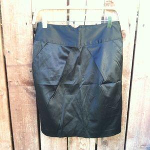 Satin like material mid length skirt,